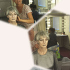 Isobel styling hair and applying stage make-up